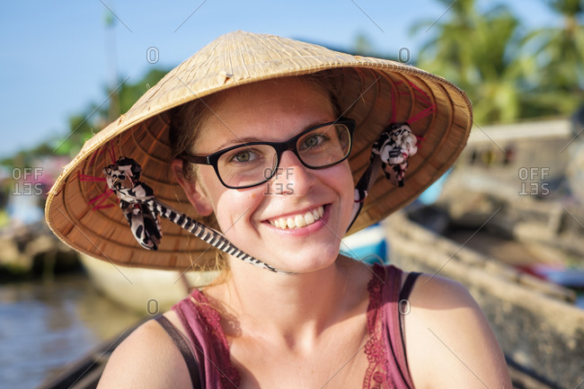 Young caucasian tourist wearing Vietnamese conical hat