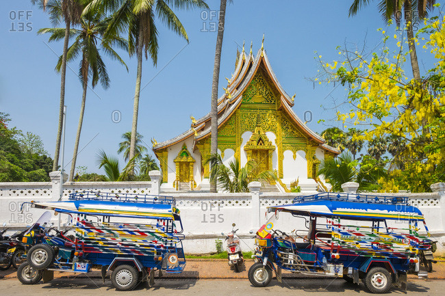 Colorful Tuk-tuks in front of Haw Pha Bang temple, Luang Prabang