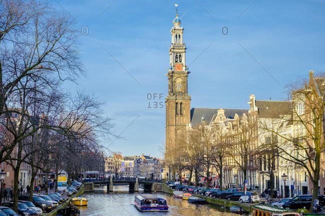Amsterdam, North Holland, Netherlands - December 28, 2015: Westerkerk church and Prinsengracht canal, Amsterdam, Netherlands