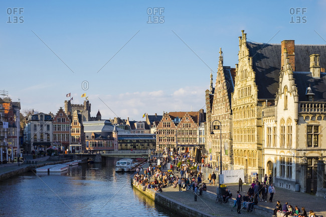 Ghent, Flanders, Belgium - April 10, 2016: Medieval guild houses on Graslei and the Leie River, Ghent, Belgium