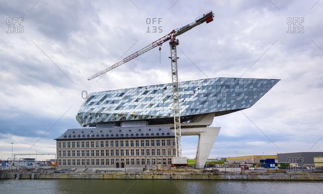 Antwerp, Flanders, Belgium - April 11, 2016: Nieuw Havenhuis, one of the final projects of architect Zaha Hadid, Antwerp, Belgium