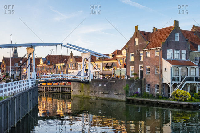 Enkhuizen, North Holland, Netherlands - May 4, 2016: Drawbridge and historic houses at the entrance of the Oude Haven (Old Harbor), Enhuizen, North Holland, Netherlands