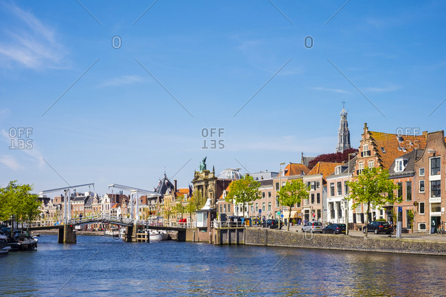 Haarlem, North Holland, Netherlands - May 6, 2016: Buildings along the Spaarne River with Gravestenenbrug drawbridge, Haarlem, North Holland, Netherlands