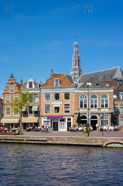 Haarlem, North Holland, Netherlands - May 6, 2016: Buildings along the Spaarne River, Haarlem, North Holland, Netherlands