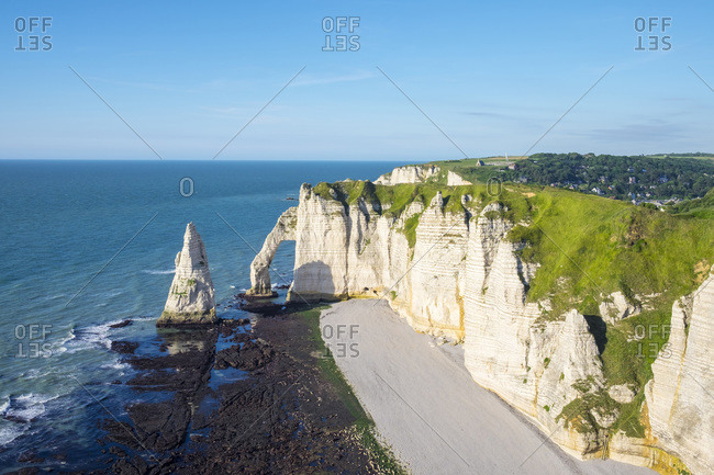 White chalk cliffs and Aiguille d'Etretat, natural stone arch on the English Channel, Etretat, Seine-Maritime department, Normandy, France