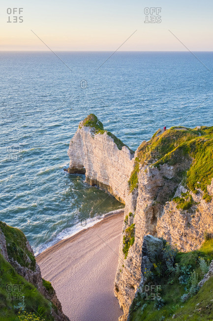 White chalk cliffs on the coast of the English Channel at sunset, Etretat, Seine-Maritime department, Normandy, France