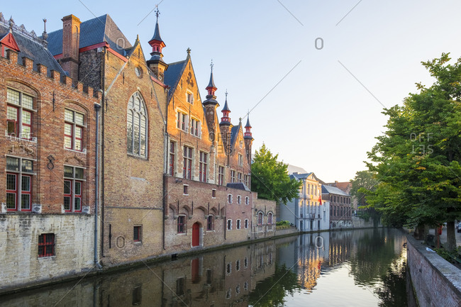 Bruges, Flanders, Belgium - August 17, 2016: Brugse Vrije and buildings along the Groenerei canal, Bruges, West Flanders, Belgium