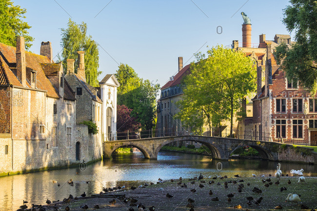 Wijngaard Bridge and the main entrance gate of the Begijnhof, Bruges, West Flanders, Belgium