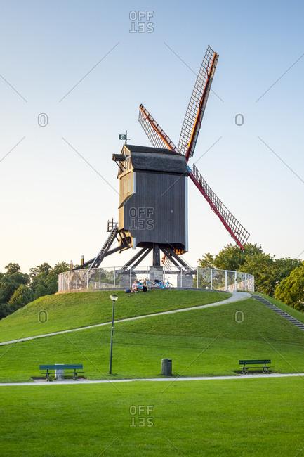 Bruges, Flanders, Belgium - August 17, 2016: Sint-Janshuis Mill (Sint-Janshuismolen) windmill on the Kruisvest park, Bruges, West Flanders, Belgium