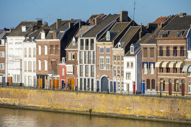 Maastricht, Limburg, Netherlands - September 9, 2016: Building along the Meuse (Maas) River in the Wyck-Ceramique quarter, Maastricht, Limburg, Netherlands