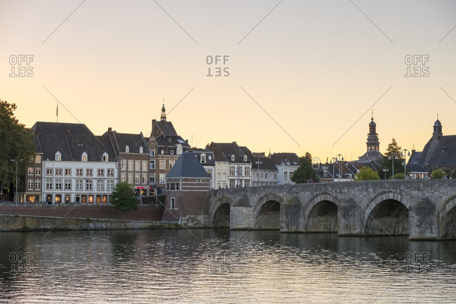 Maastricht, Limburg, Netherlands - September 9, 2016: Buildings in the old town along the Meuse (Maas) River, Maastricht, Limburg, Netherlands