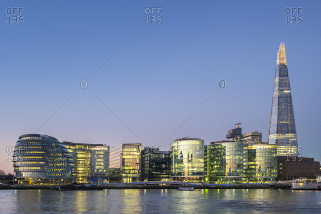 London, England, United Kingdom - January 20, 2017: London City Hall by architecht Norman Foster (left), The Shard by architecht Renzo Piano (right), and modern buildings in the Borough of Southwark at dawn, London, England, United Kingdom