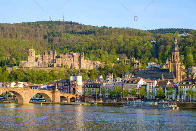Heidelberg, Baden-W�rttemberg, Germany - April 11, 2017: Alte Brucke and buildings in the old town on the Neckar River, Heidelberg, Baden-W�rttemberg, Germany