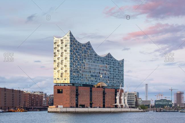 Hamburg, Germany - April 16, 2017: Elbphilharmonie (Elbe Philharmonic Hall) on the Elbe River at sunset, Hamburg, Germany