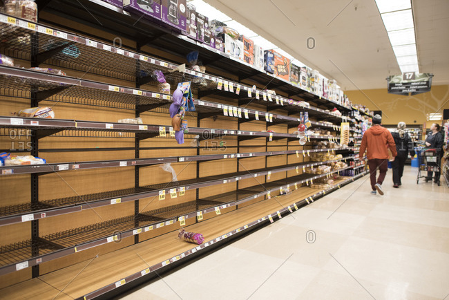 San Diego, California, United States - March 13, 2020: Empty bread shelves in a supermarket due to Coronavirus.