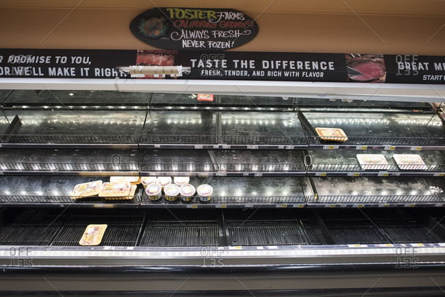 San Diego, California, United States - March 13, 2020: An almost sold out meat section of a market due to Coronavirus.