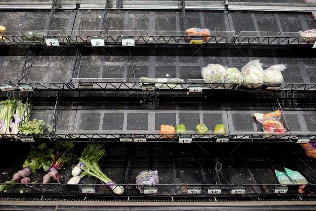 San Diego, California, United States - March 13, 2020: An almost sold out produce section of a market due to Coronavirus.