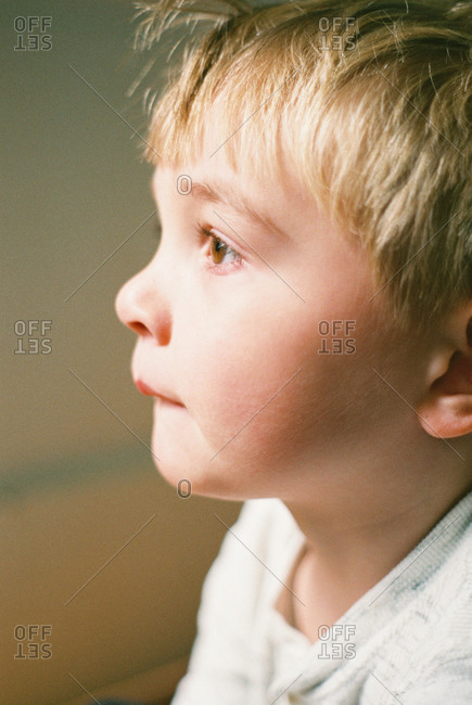 Little boy looking out the window, captured on film.