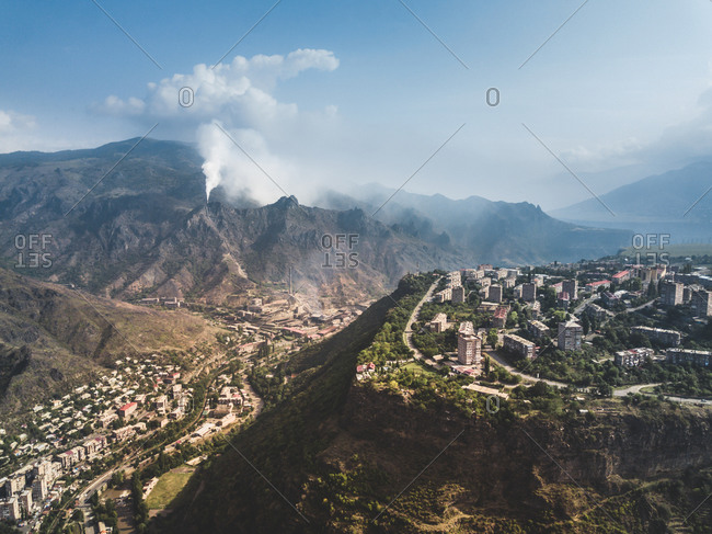 Aerial view of city infrastructure on the top and valley and industrial production in the mountains, Alaverdi, Armenia.