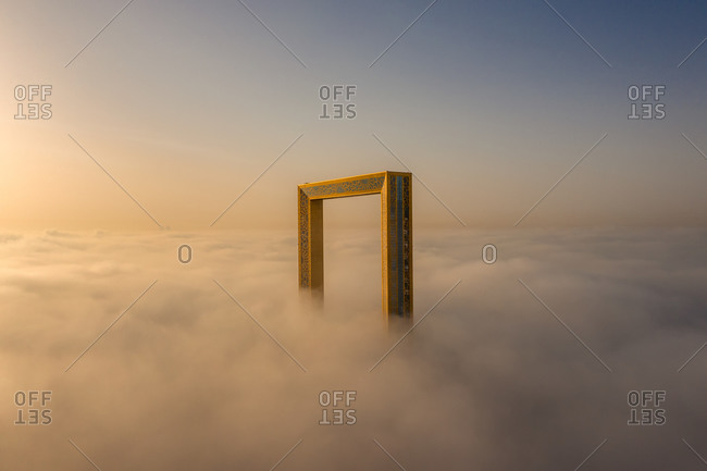 March 29, 2019: Aerial view of frame surrounded by clouds during sunset, Dubai, United Arab Emirates
