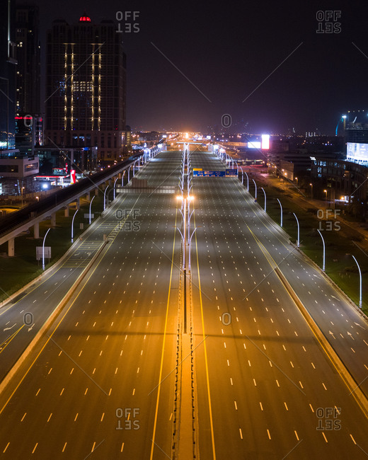 March 29, 2020: Aerial view of empty streets at night due to the coronavirus pandemic in Dubai, United Arab Emirates