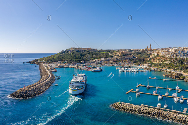 April 14, 2020: Aerial view of a Ferry entering the harbor on Gozo, Malta.