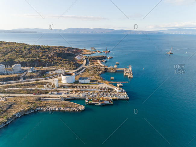 Aerial view of the construction of future LNG terminal on the shore of the bay in Omisalj, Croatia