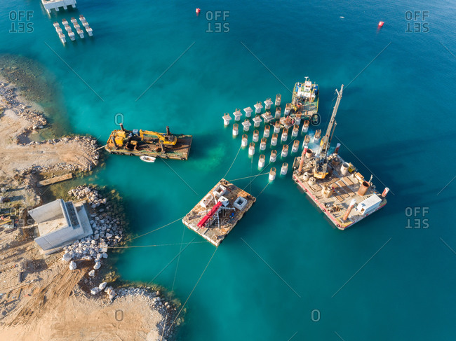 November 30, 2019: Aerial view of machinery at the construction of future LNG terminal on the shore of the bay in Omisalj, Croatia