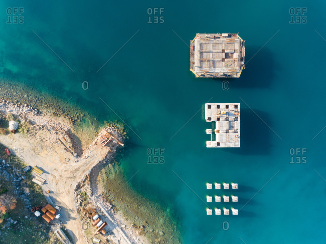 Aerial view of concrete platforms at the construction of future LNG terminal on the shore of the bay in Omisalj, Croatia