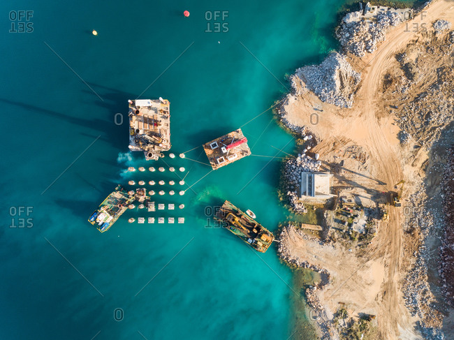 Aerial view of machinery on concrete platforms at the construction of future LNG terminal on the shore of the bay in Omisalj, Croatia