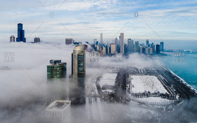 April 14, 2020: Aerial view of dense fog covering Chicago skyscraper during the winter, United States.