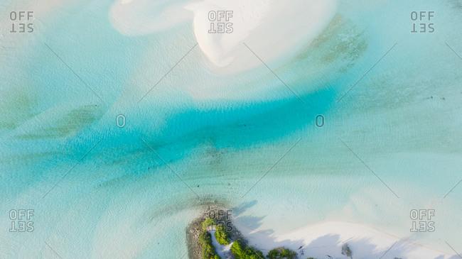 Aerial view of a sandbank and drifting sand creating an abstract pattern at the shore of Mathiveri, Maldives, Alif Alif Atoll, Indian Ocean