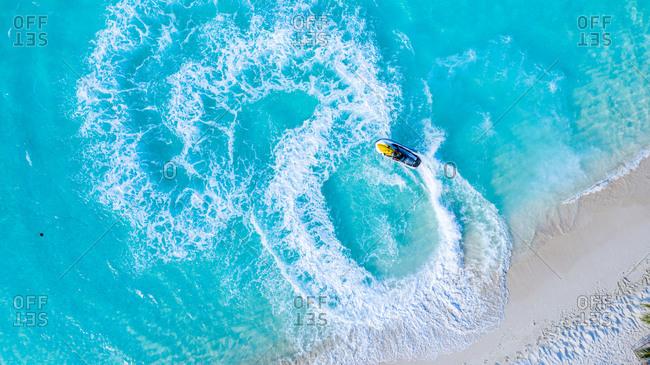 Aerial View of a jet ski, Vashafaru, Haa Alif Atoll, Maldives, Indian Ocean, riding circles