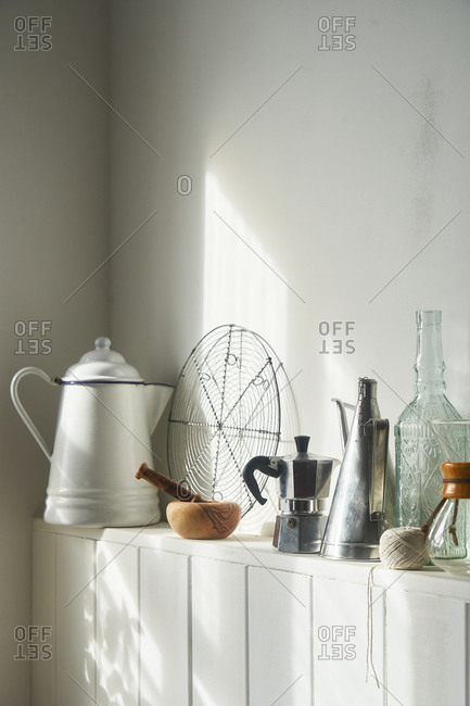 Rustic farmhouse kitchenware on white shelf