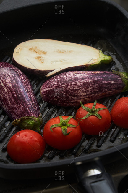 Fresh tomatoes and eggplant in a skillet