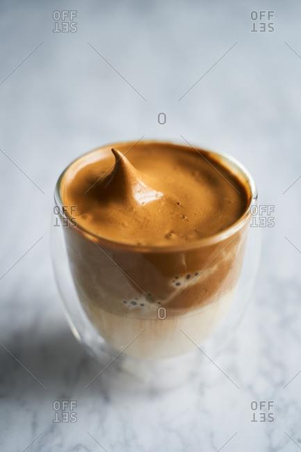 Dalgona whipped coffee on light background