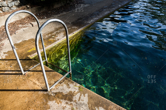 Stairs leading to a clear water thermal pool