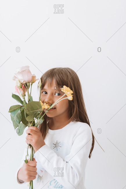 Young girl holding a variety of spring flowers