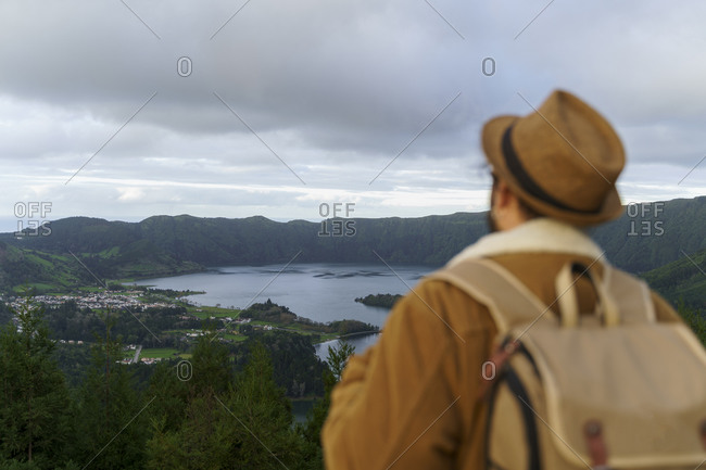 Rear view of man looking at scenic landscape- Sao Miguel Island- Azores- Portugal