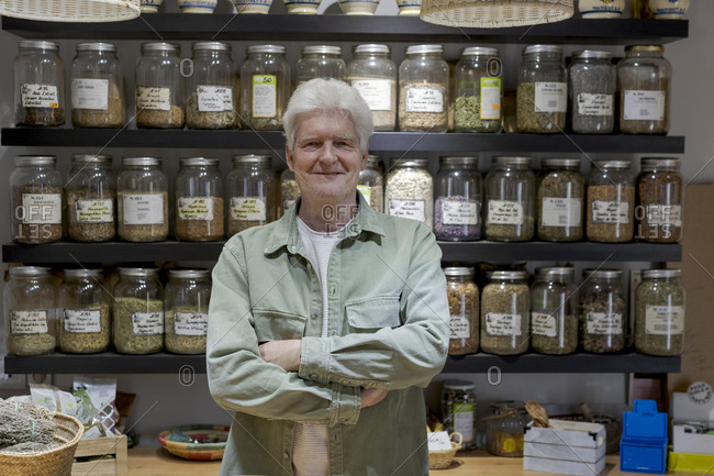 Portrait of confident senior man in his shop
