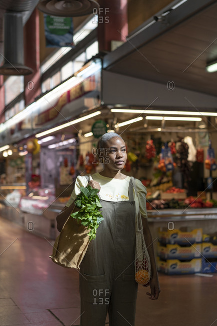 Woman buying groceries in a market hall