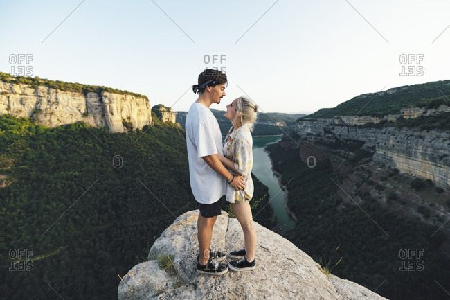 Young couple in love standing on viewpoint- Sau Reservoir- Catalonia- Spain