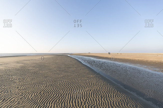 Denmark- Romo- Clear sky over rippled beach