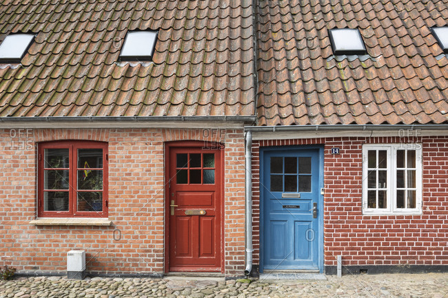 April 11, 2017: Denmark- Ribe- Facade of brick house with tiled roof
