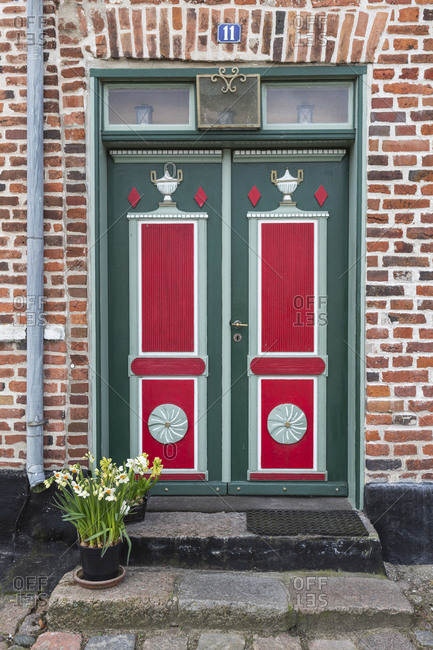 April 11, 2017: Denmark- Ribe- Ornate entrance doors of brick town house