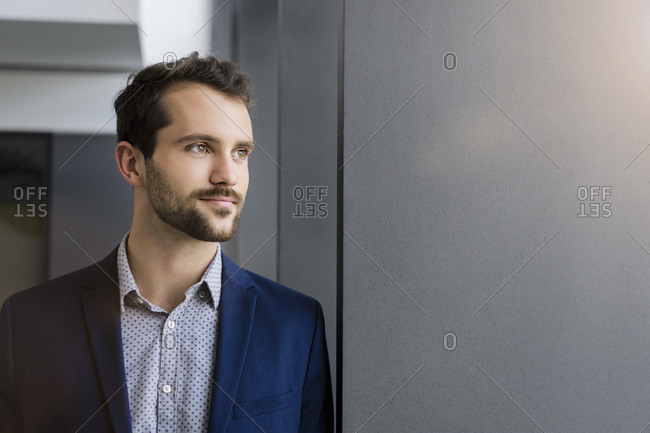 Portrait of young businessman looking at distance