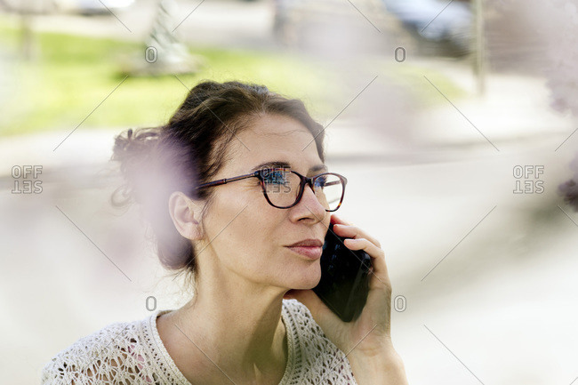 Portrait of mature woman on the phone outdoors