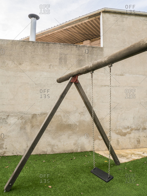 Spain- Simple swing standing on artificial grass