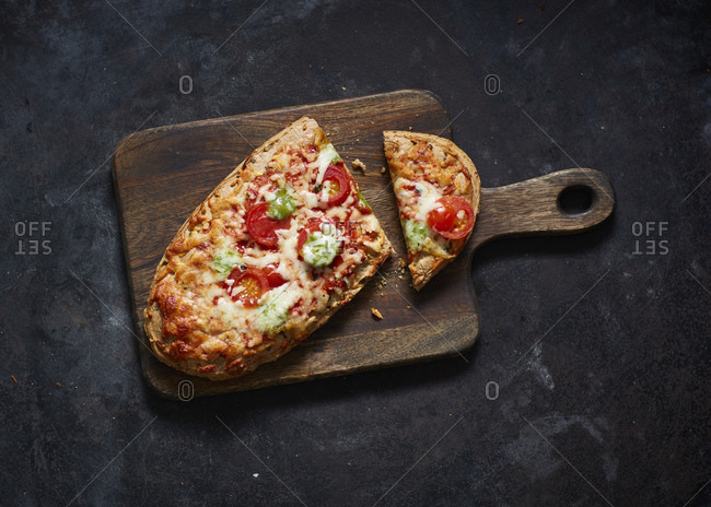 Baked baguette with lettuce- tomatoes and cheese