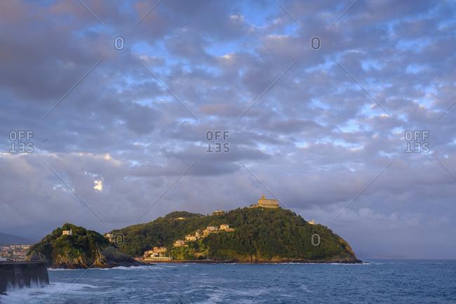 Spain- Gipuzkoa- San Sebastian- Clouds over Monte Igueldo at dusk